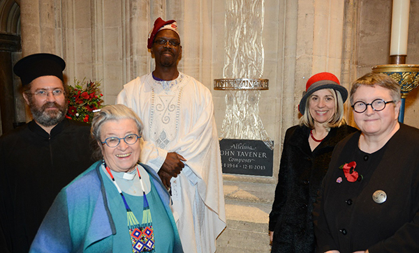 The Rev Andreas Andreopoulos, Dr Olu Taiwo, Professor Joy Carter, the University Vice-Chancellor, Professor Elizabeth Stuart, the Deputy Vice-Chancellor and the Rev Professor June Boyce-Tillman, Director of the Tavener Centre, in front of the memorial statue to Sir John Tavener